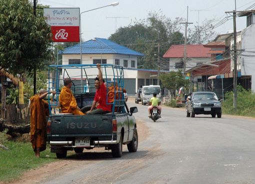 Monks boarding a pickup truck in Kalasin, Thailand