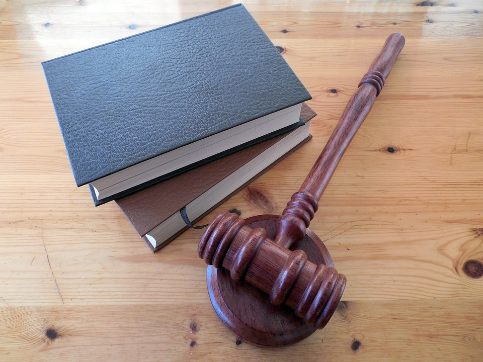 Wooden Judge hammer and law books