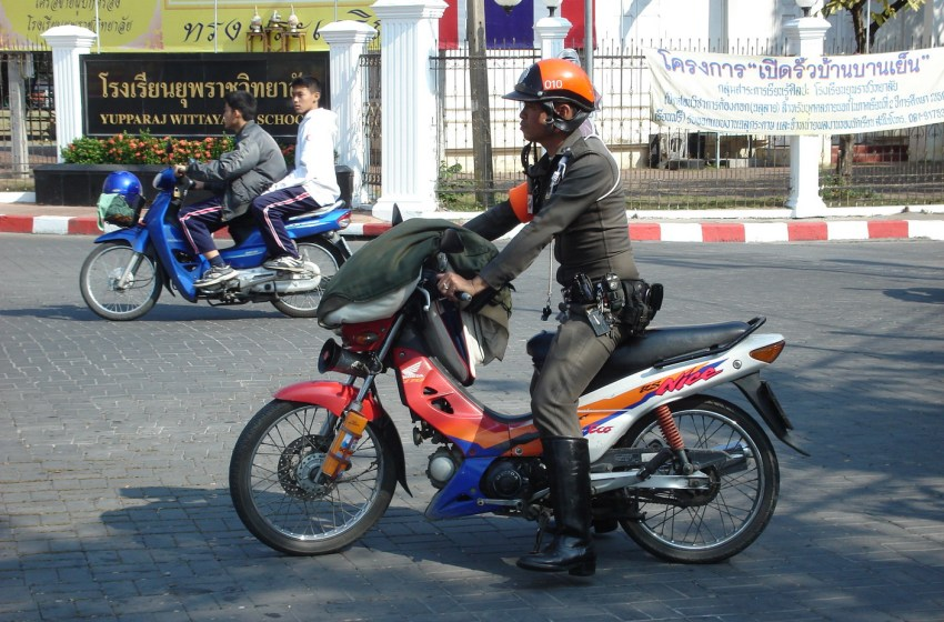 Thai police officer riding a motorcycle