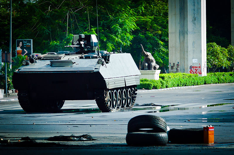 A Type-85 AFV assaulting a Red Shirt barricade in Bangkok
