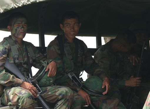 Royal Thai marines sit in the back of a troop carrier during exercise Cobra Gold 2010 at Utapao Air Base, Rayong province