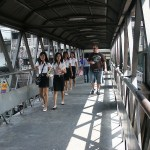 Thai schoolgirls at pedestrian overpass in Bangkok