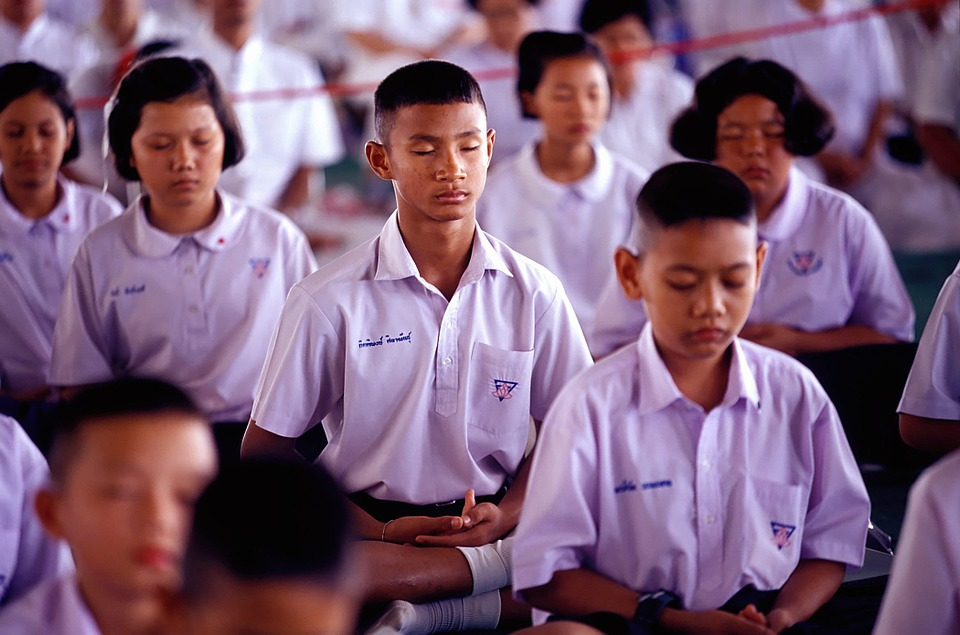 Thai students practicing Yoga