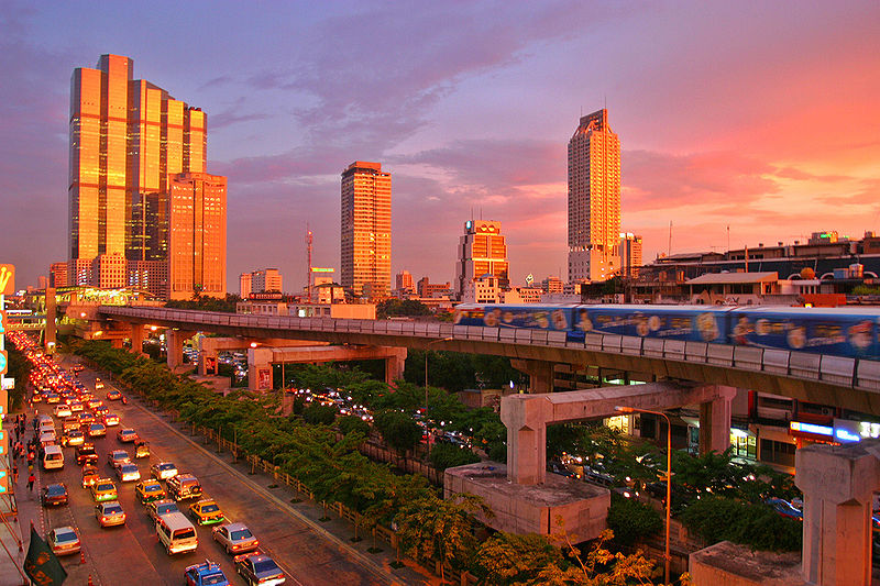 Bangkok skyline and skytrain on sunset