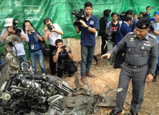 Police inspecting burnt out cars in Thailand's restive South