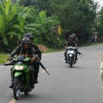 Thai troops patrolling a village in Pattani, to protect Buddhist teachers