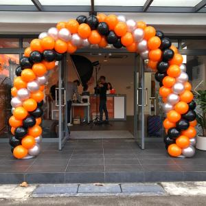 Orange Black and Silver Balloon Arch