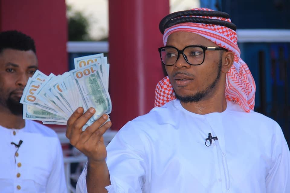 bishop daniel obinim flaunts $100 notes as he celebrates release from police custody