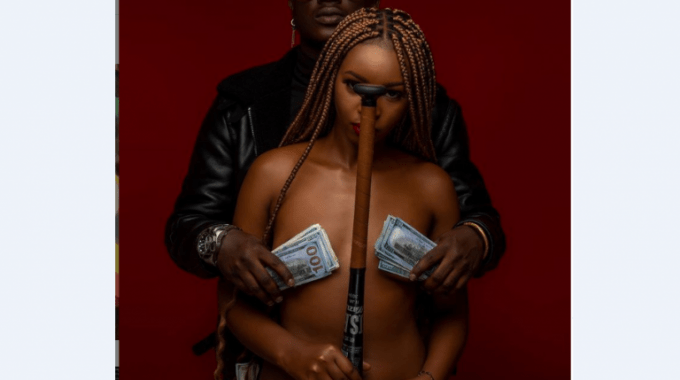 Rapper Gravity Omutujju Parades Stunning Babe With Juicy Boobs As He Tips Fans On His Next Colorful Music Video