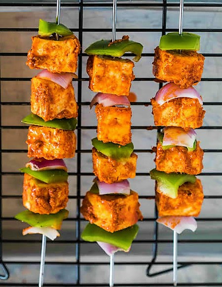 An easy to cook vegetarian food is Paneer tikka that could be loved by in Christmas