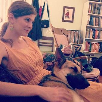 Abby holds her German shepherd foster dog