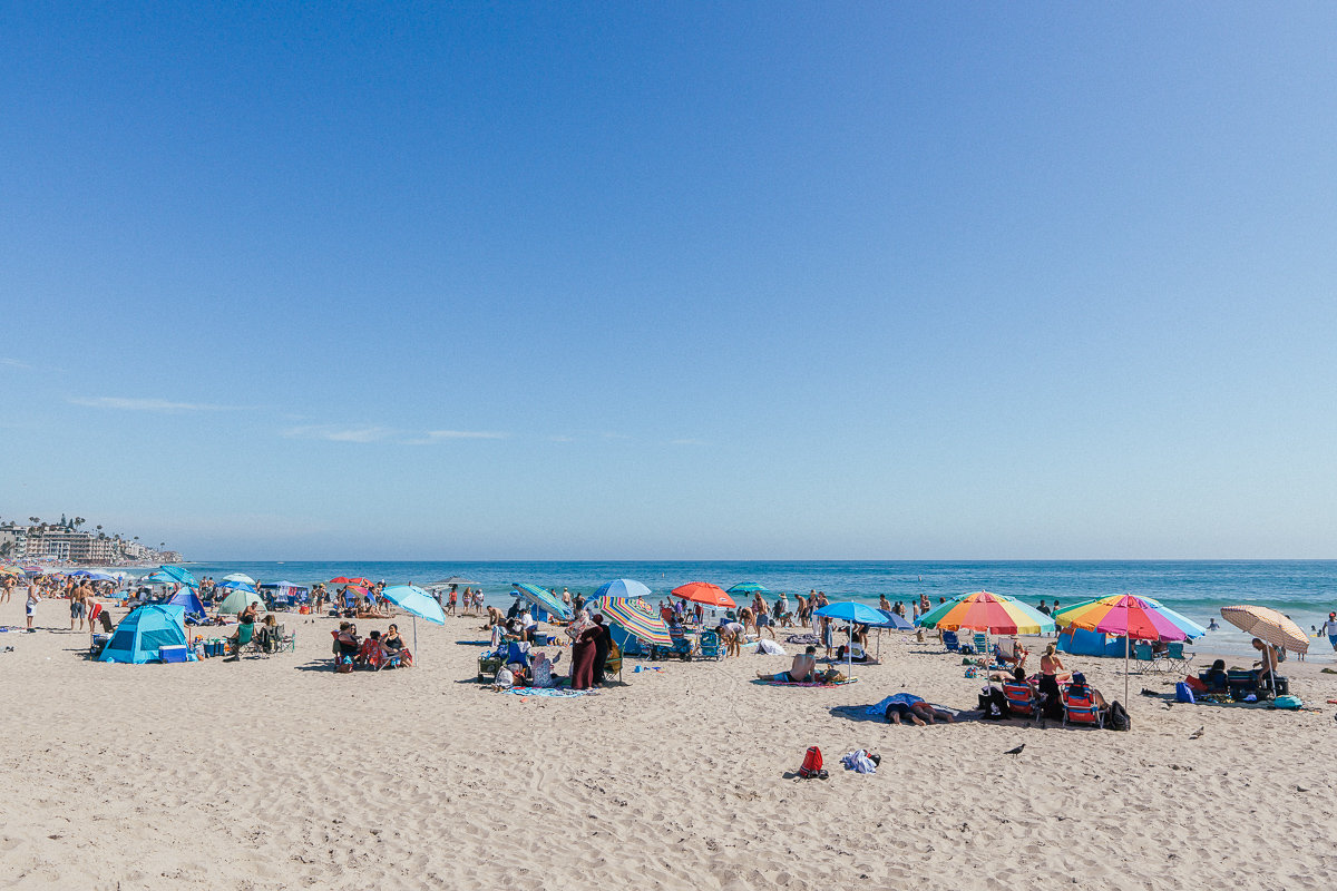 Bring your umbrella for a day of fun in the sun at Laguna's Main Beach.
