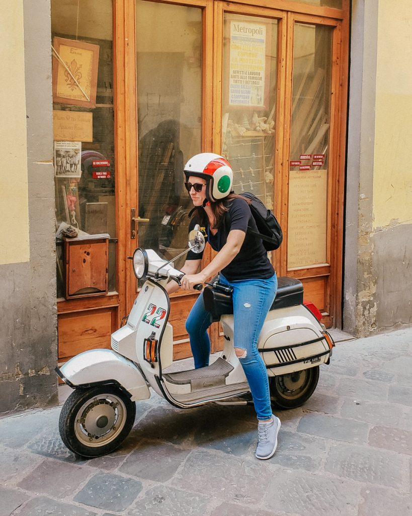 Riding a Vespa scooter in Florence
