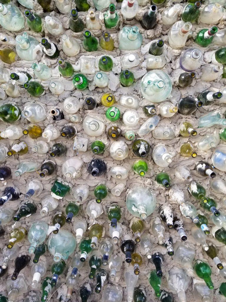 Glass bottle art display in East Jesus