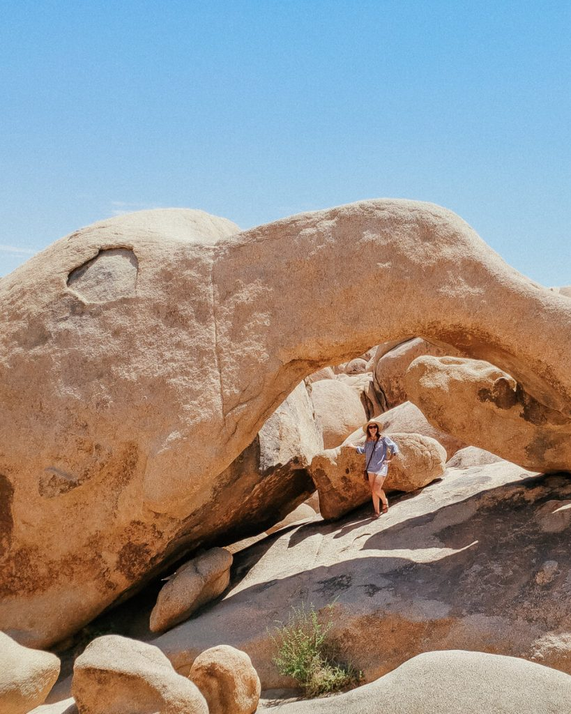 Standing under Arch Rock in Joshua Tree National Park