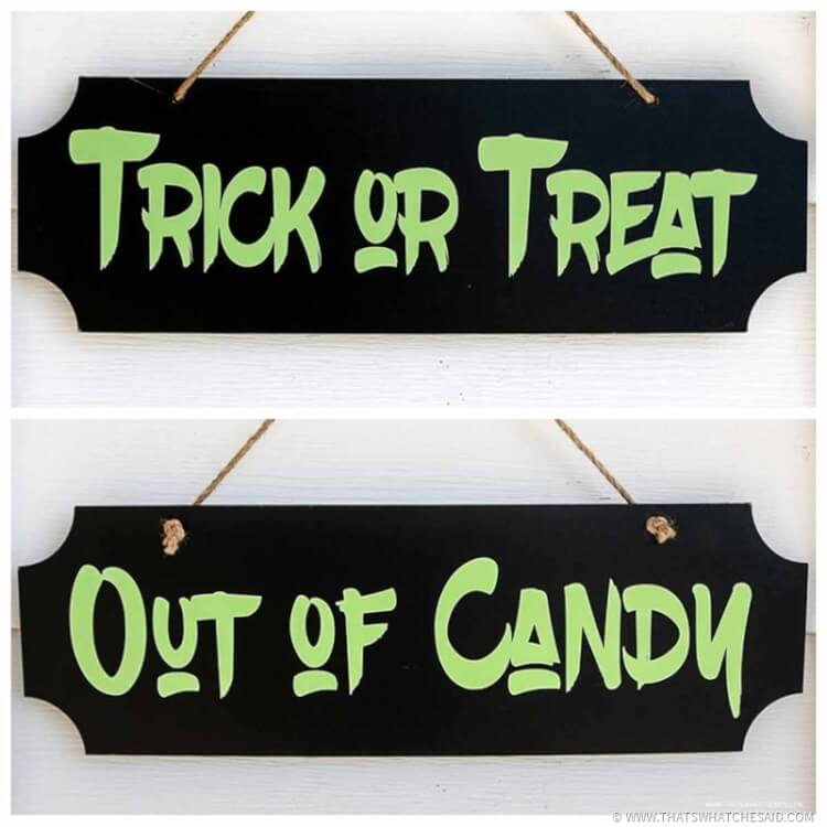 Dual sided out of candy and trick or treat sign
