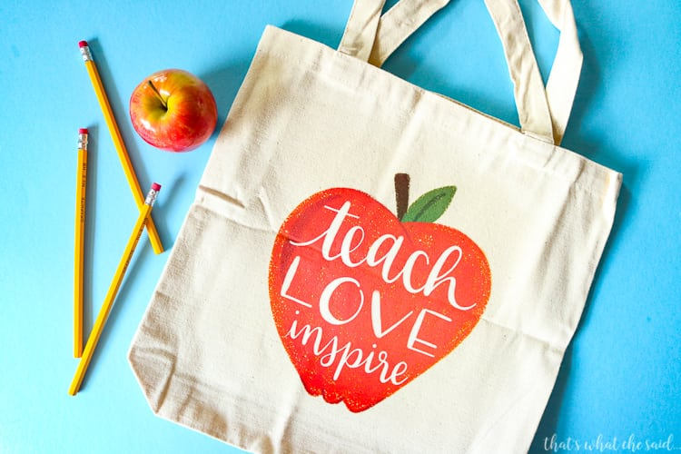 Tote Bag with Teach Love Inspire inside an apple.