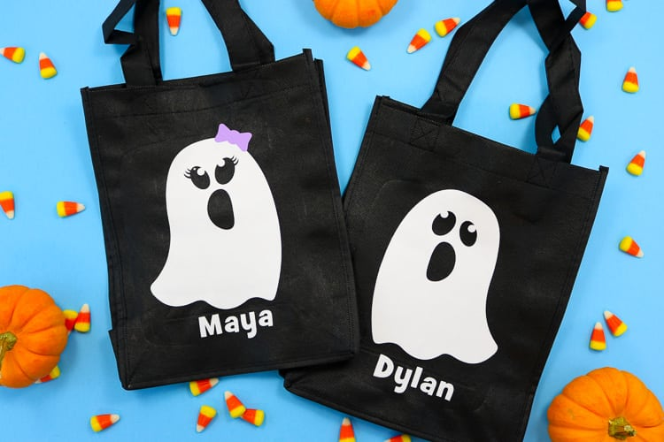 Black reusable tote bags with white boy and girl ghost decals