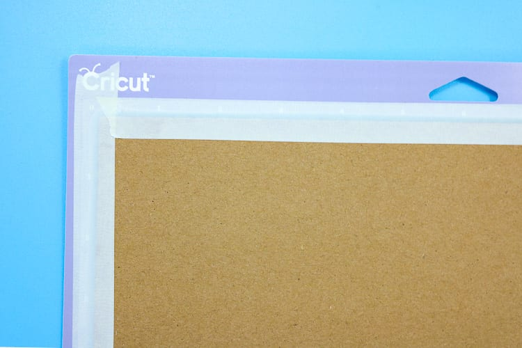 Purple Cricut Mat with Chipboard taped down with masking tape