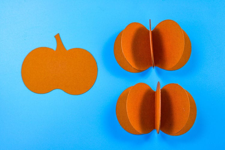Complete the assembly of the paper pumpkin