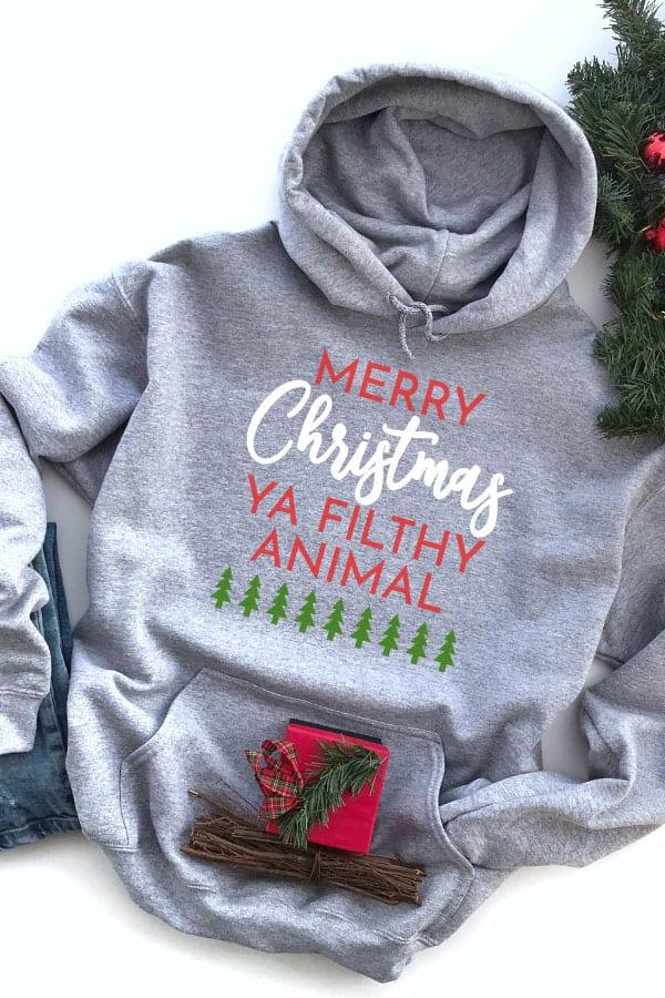 Merry Christmas Ya Filthy Animal SVG file on a Hoodie for Christmas