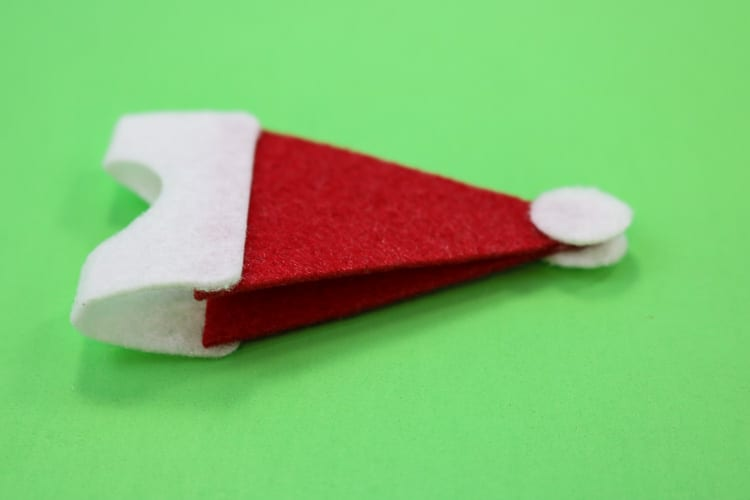 Last Santa Hat Assembly step is to add white circles to both sides of the Santa hat