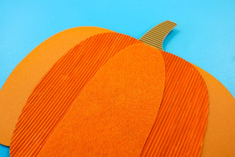 Close up of mixed media pumpkin layers
