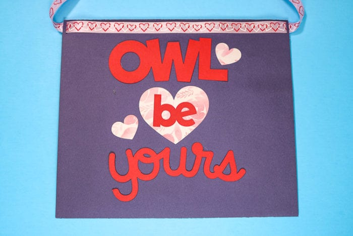 Back of purple envelope valentine box with owl be yours on it with cardstock and patterened iron on
