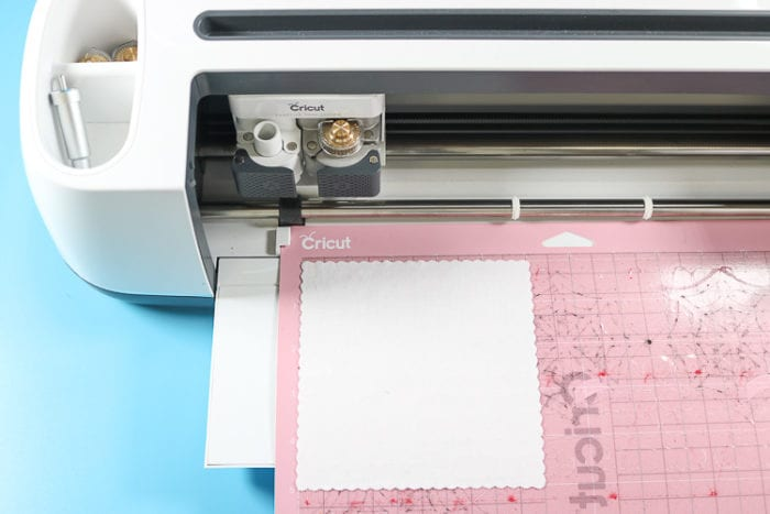 Cricut Maker with FabricGrip mat and white cotton fabric