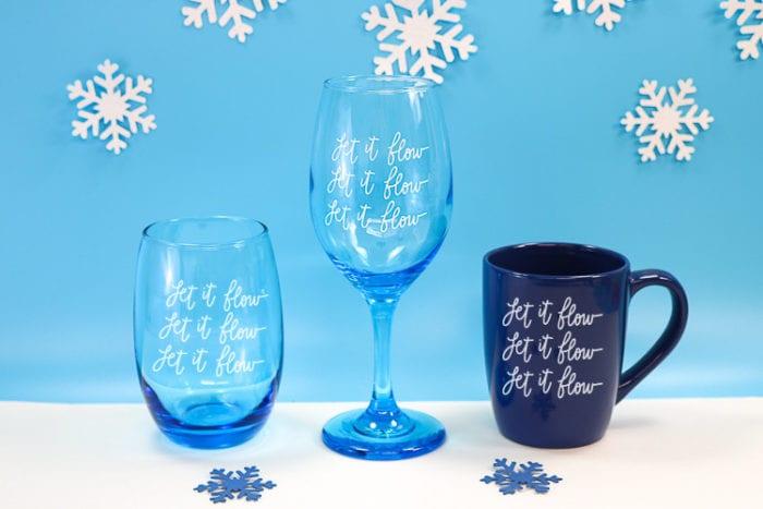 Stemless Wine glass, regular wine glass and coffee mug with Let it Flow, Let it Flow, Let it Flow vinyl decal