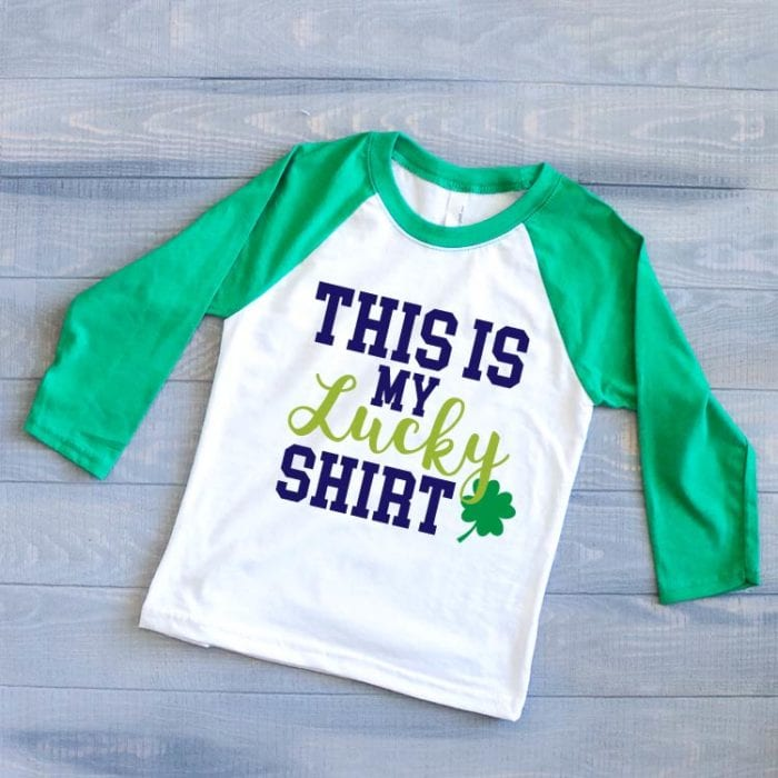 """Kid's Green & White Raglan with the St. Patrick's day SVG """"This is my Lucky Shirt"""""""