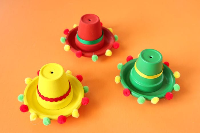Clay Pots painted and embellished to resemble sombreros for a fiesta party