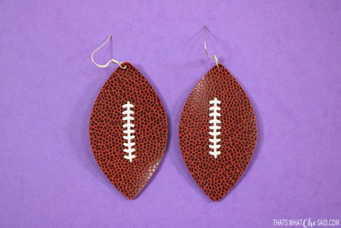Football shaped earrings cut in faux football leather