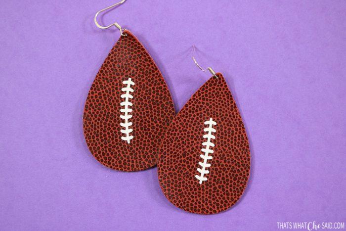 Teardrop earrings cut in faux football leather