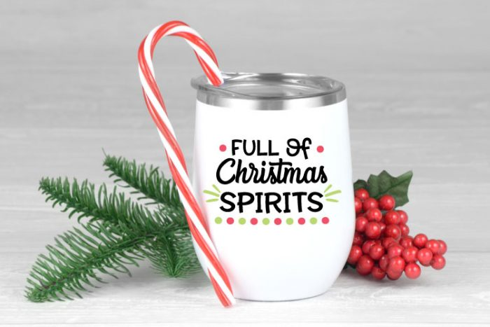 """White insulated wine tumbler with """"Full of Christmas Spirits"""" in black, red and green adhesive vinyl"""