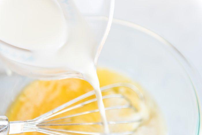 adding milk to egg mixture