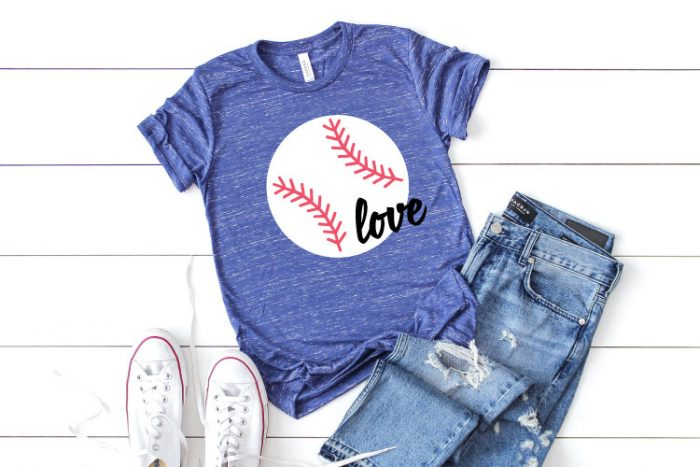 Blue Heather T-Shirt with Baseball design and the word love in iron on vinyl staged with white converse and ripped jeans