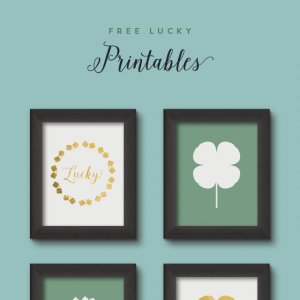4 framed St. Patrick's Day Free Printables on a wall.