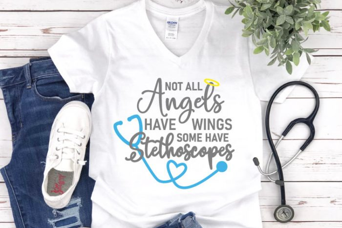 """White shirt with jeans and tennis shoes and a stethoscope.  Shirt reads""""Not all Angels Have wings, some have stethoscopes"""""""