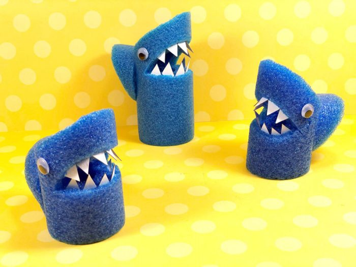 Pool noodles made into sharks with paper teeth and googely eyes.