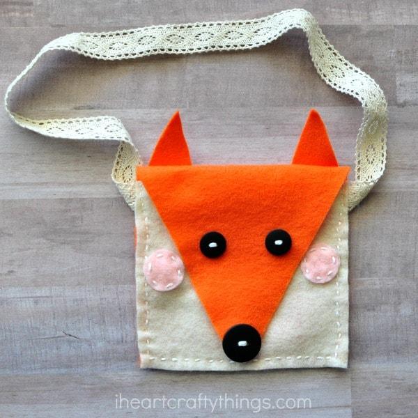 Felt fox head pocket purse.