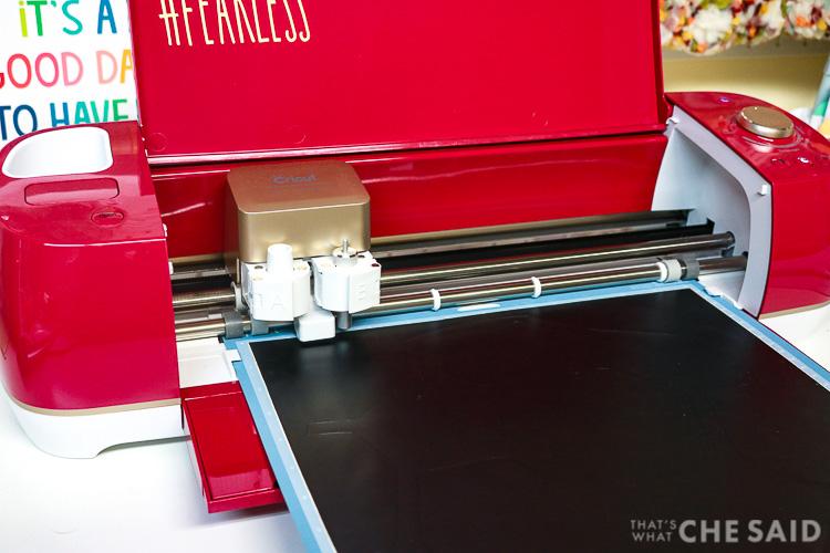 Cricut Explore Air 2 cutting black adhesive vinyl.