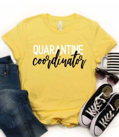 """Yellow shirt with """"Quarantine Coordinator"""" in iron on with jeans, converse coffee mug and sunglasses - Vertical"""