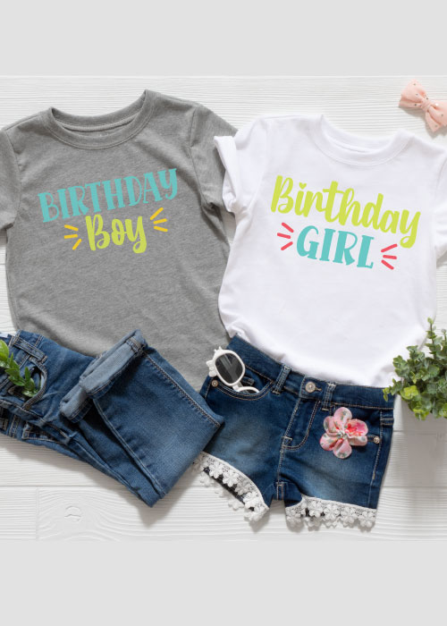 Two outfits, one girl and one boy with the Birthday Girl and Birthday Boy SVG files in iron-on in vertical format