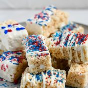 Serving tray full of patriotically decorated Rice Krispie Treats - Vertical Shot