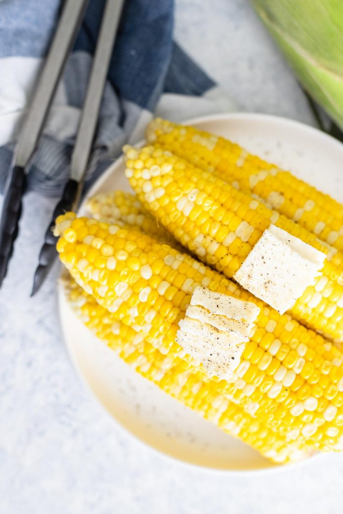 IP Corn on the Cob - Cobs on a plate with butter pats