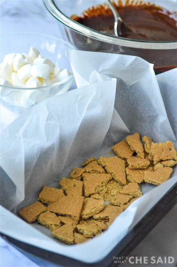 Graham cracker pieces in parchment lined loaf pan