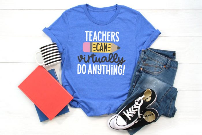 """Blue T-shirt with jeans, converse, a coffee mug and folders that has the SVG File """"Teachers Can Virtually Do Anything"""" in iron on in horizontal orientation"""