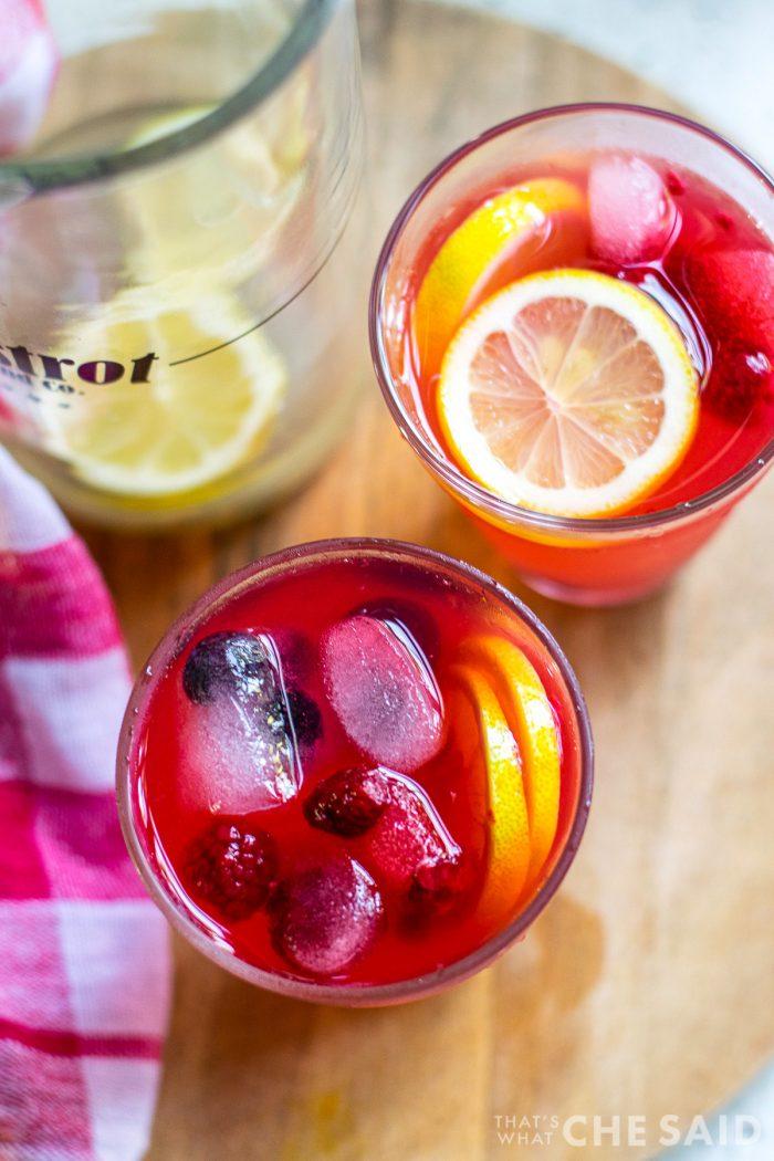 Overhead view of garnished berry lemonade.