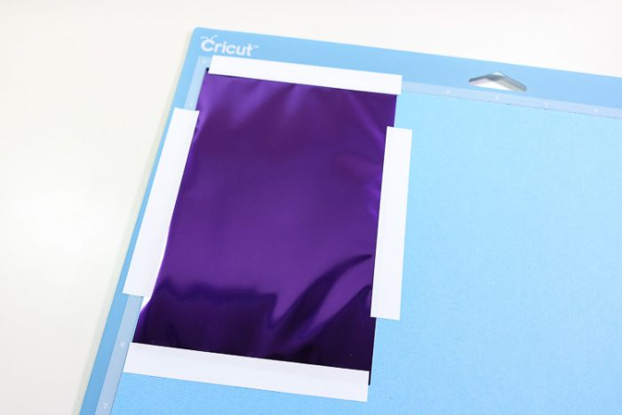 Foil placed on cardstock and taped down using adhesive strips